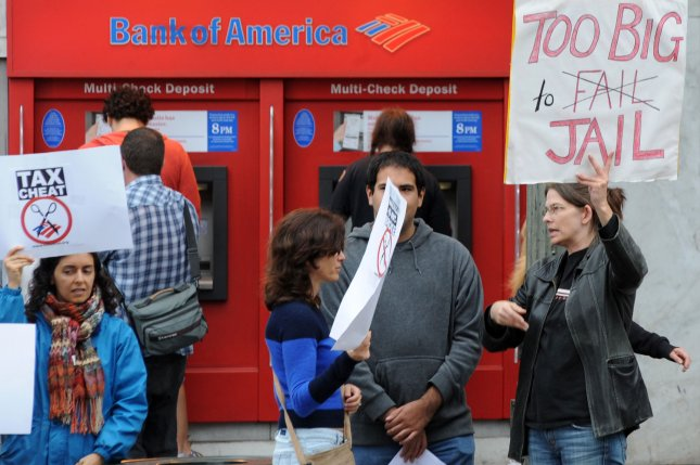 Demonstrators protest corporate tax cuts vs. governmental budget cuts to education, health care and the environment outside a Bank Of America in the Hollywood section of Los Angeles on April 18, 2011. UPI/Jim Ruymen