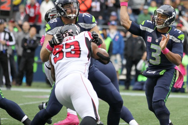 Seattle Seahawks quarterback Russell Wilson (3) his hit after he throws a pass by Atlanta Falcons defensive end Adrian Clayborn (99) during the fourth quarter at CenturyLink Field in Seattle, Washington on October 16, 2016. Wilson completed 25 of 37 passes for 270 yards in the Seahawks 26-24 win over the Falcons . Photo by Jim Bryant/UPI