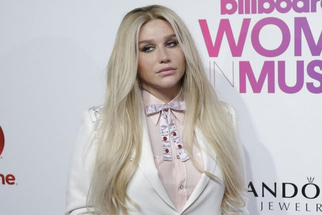 Kesha arrives on the red carpet at the Billboard Women in Music 2016 event on December 9. Kesha showed her support for Taylor Swift on Twitter writing that she admires the fellow singer's strength. File Photo by John Angelillo/UPI