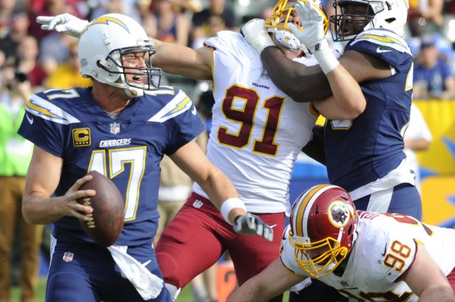 Los Angeles Chargers' Philip Rivers runs out of the pocket in the first half against the Washington Redskins at StuHub Center in Carson, California on December 10, 2017. The Chargers won 30-13. Photo by Lori Shepler/UPI