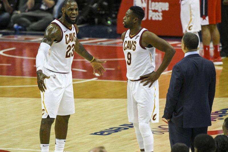 Cleveland Cavaliers forward LeBron James (23) has words with head coach Tyronn Lue as guard Dwyane Wade (9) looks on November 3 at Capital One Arena in Washington, D.C. Photo by Mark Goldman/UPI