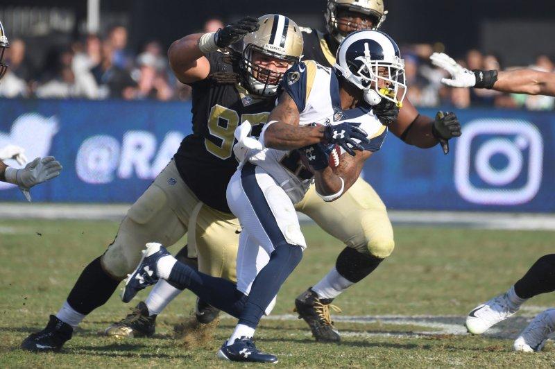 Ex-New Orleans Saints defensive lineman Tyeler Davison (L) will visit with the Atlanta Falcons. He spent the last four seasons with the Saints. File Photo by Jon SooHoo/UPI