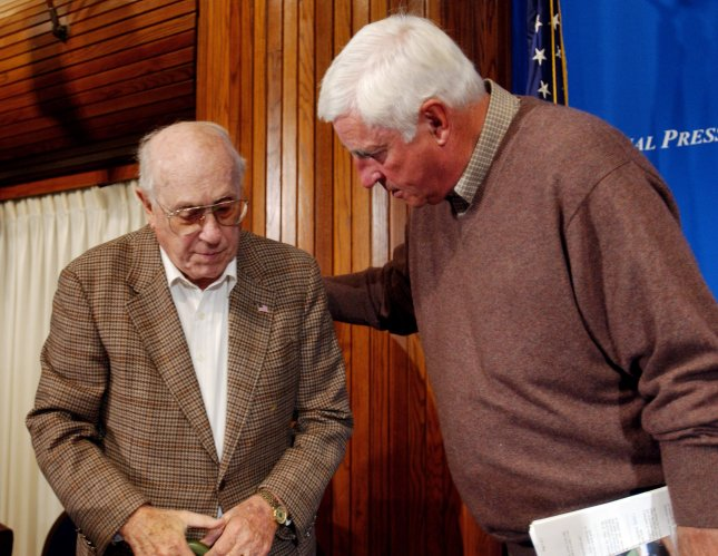 Texas Tech University basketball coach Bobby Knight speaks to Famed Coach Red Auerbach at an event at the National Press Club in Washington on September 27, 2004. Knight discussed the current state of College Basketball, the NBA and the U.S. Olympic team's performance in the 2004 games...(UPI Photo/Michael Kleinfeld)..