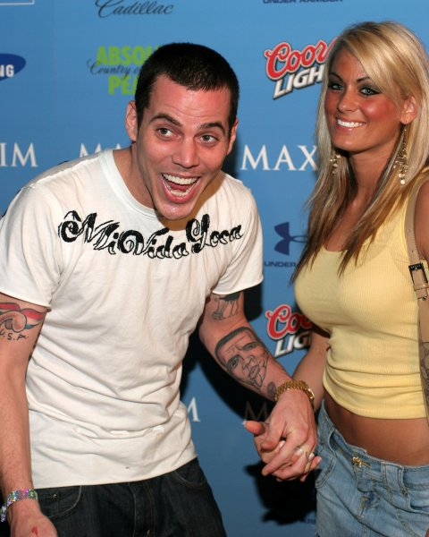 Steve-O and guest arrive for the Hotel De Maxim Super Bowl party at the Sagamore Hotel on Miami Beach, on February 2, 2007. (UPI Photo/Martin Fried)