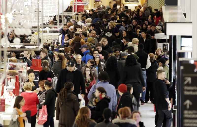 Shoppers walk through Macy's in New York's Herald Square on Nov. 29, 2013. UPI/John Angelillo