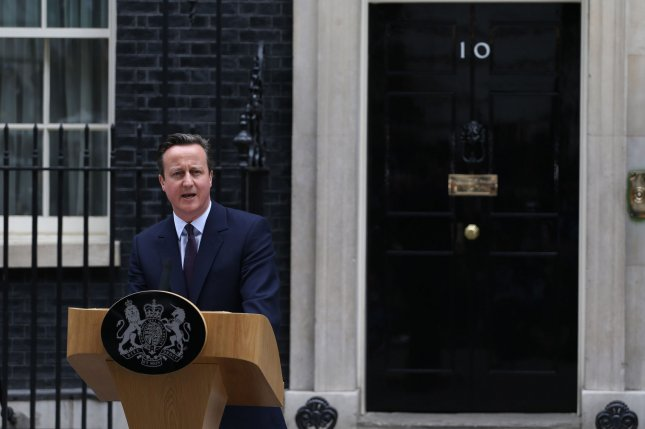 British Prime Minister David Cameron speaks to the media about his vision for the country outside No.10 Downing St after securing a majority for the Conservative Party and a further five year term in the 2015 UK General Election in London on May 08, 2015. On Thursday, Cameron warned illegal immigrants Britain should not be considered a safe haven after disturbances in Calais, France. File Photo by Hugo Philpott/UPI Photo by Hugo Philpott/UPI