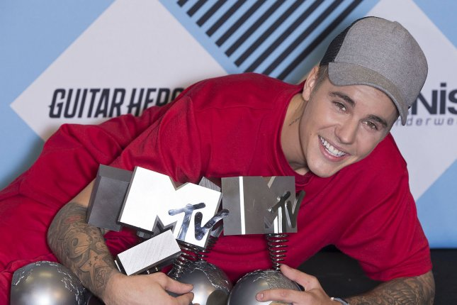 """Justin Bieber arrives in the photo room during the MTV Europe Music Awards in Milan, Italy on Oct. 25, 2015. Bieber took home four awards during the event including Best Male Artist. Bieber also performed his Hot 100 topping smash """"What Do You Mean?"""" Photo by David Silpa/UPI"""