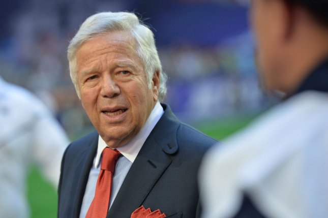 New England Patriots owner Robert Kraft (L) talks with a player before Super Bowl XLIX against the Seattle Seahawks at University of Phoenix Stadium in Glendale, Arizona, February 1, 2015. Photo by Kevin Dietsch/UPI