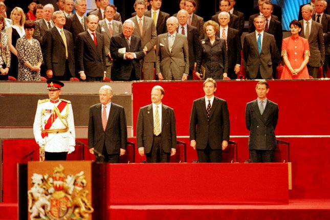 Among the personalities attending the handover of Hong Kong to China, June 30, 1997, were (front R to L) Prince Charles, Prime Minister Tony Blair, Foreign Secretary Robin Cook and Hong Kong Governor Chris Patten. Former Prime Minister Margaret Thatcher and her husband Dennis were in the back row. UPI File Photo