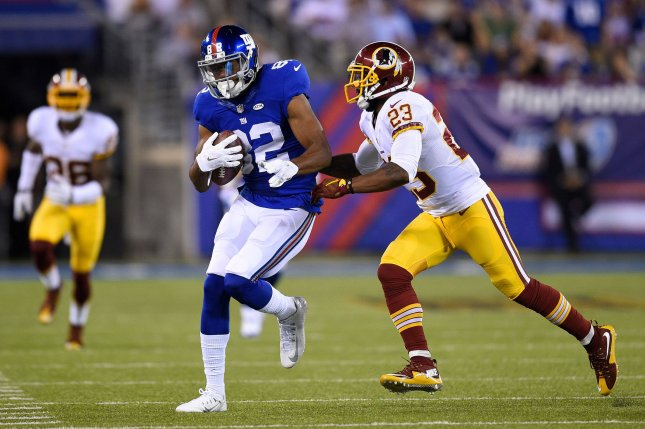 New York Giants wide receiver Rueben Randle (82) pulls in a 30-yard reception against Washington Redskins cornerback DeAngelo Hall (23) in the first quarter in Week 3 of the NFL season on September 24, 2015 at MetLife Stadium in East Rutherford, New Jersey. File photo by Rich Kane/UPI