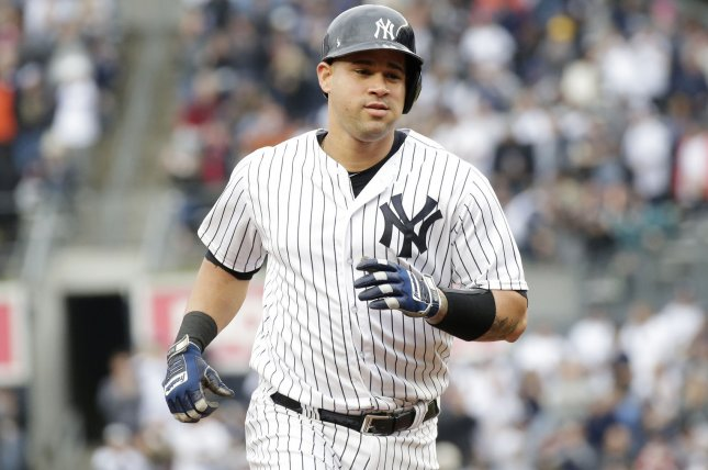 New York Yankees' Gary Sanchez hits a solo home run in the 2nd inning against the Oakland Athletics on May 12 at Yankee Stadium in New York City. Photo by John Angelillo/UPI