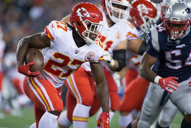 Kansas City Chiefs running back Kareem Hunt (27) looks for running room on a carry in the second quarter against the New England Patriots on September 7, 2017 at Gillette Stadium in Foxborough, Massachusetts. File photo by Matthew Healey/UPI