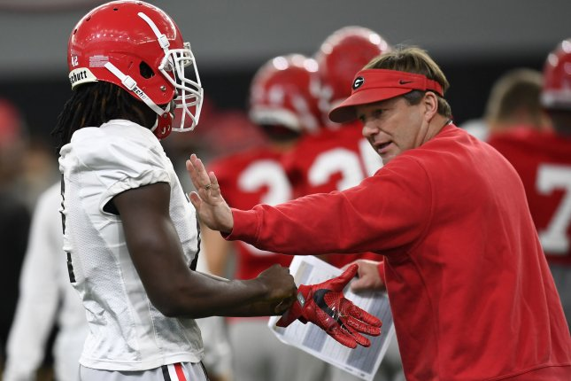 Georgia Bulldogs head coach Kirby Smart performs hands-on instructions during practice on January 6, 2018 in Athens, Georgia. Photo by David Tulis/UPI