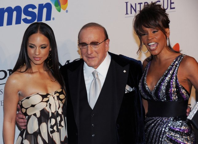 Alicia Keys, Clive Davis and Whitney Houston (L-R) attend the Clive Davis pre-Grammy party in Beverly Hills, California on February 9, 2008. (UPI Photo/Jim Ruymen)
