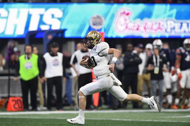 University of Central Florida Knights quarterback McKenzie Milton (10) runs for a touchdown during the Chick-fil-A Peach Bowl on January 1, 2018 at Mercedes-Benz Stadium in Atlanta. Photo by David Tulis/UPI