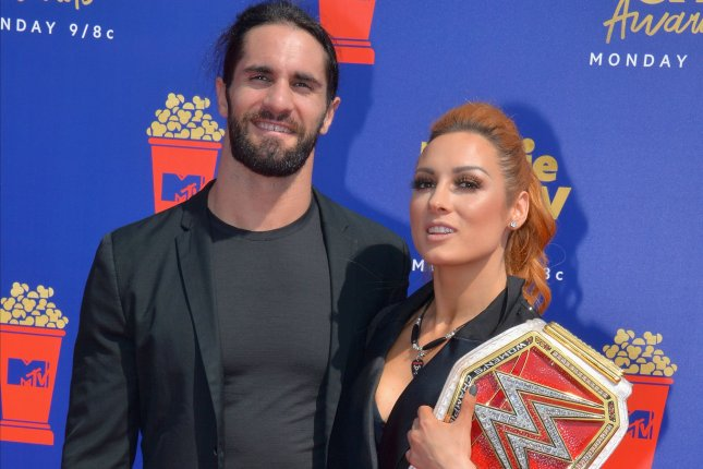 WWE's Universal Champion Seth Rollins (L) poses with his girlfriend, Raw Women's Champion Becky Lynch at the 28th annual MTV Movie & TV Awards on Saturday. Photo by Jim Ruymen/UPI