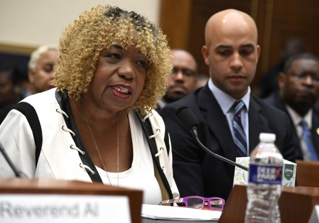 Gwen Carr makes an opening statement as former tennis player James Blake listens during testimony before the House judiciary committee on police brutality. Photo by Mike Theiler/UPI
