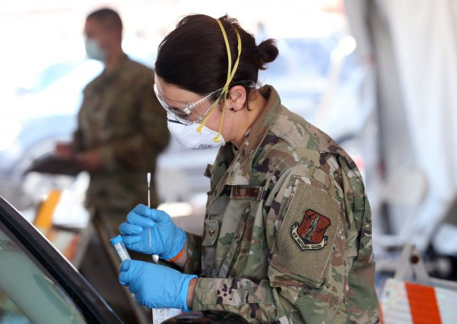 Illinois National Guard member Hannah Gonder inspects a test swab at a COVID-19 testing site in East St. Louis on May 28, 2020. Photo by Bill Greenblatt/UPI