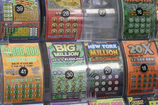 Thomas Napiorkowski of South Hadley, Mass., said he was buying a pizza when a lottery vending machine caught his eye and he ended up buying a scratch-off ticket that earned him a $1 million jackpot. File Photo by John Angelillo/UPI