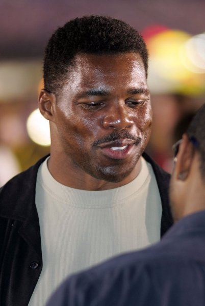 Former NFL running back Herschel Walker checks out the pits at the NASCAR NEXTEL Challenge at Lowe's Motor Speedway in Charlotte, NC on May 20, 2006. (UPI Photo/Bob Carey)