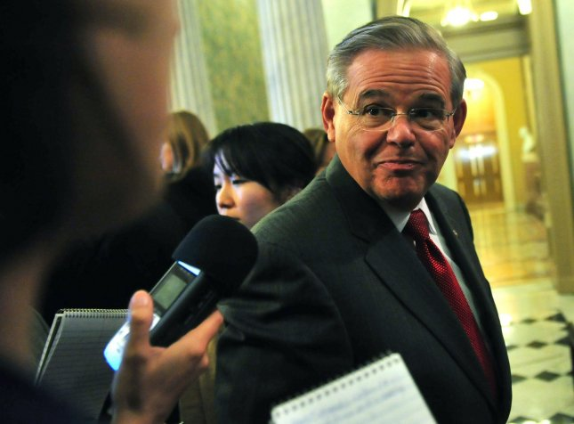 Sen. Bob Menendez (D-NJ) talks to reporters prior to casting his vote for the motion to invoke cloture on H.R 4853 (Middle Class Tax Relief Act of 2010), on Capitol Hill in Washington on December 13, 2010. UPI/Kevin Dietsch