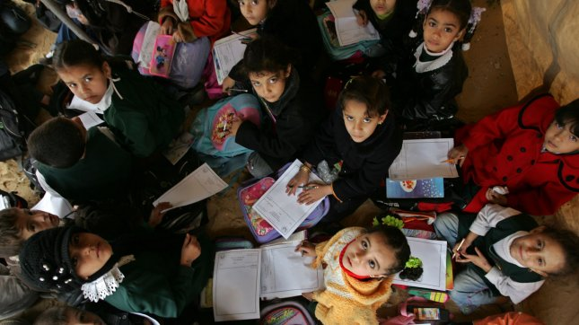 Palestinian school children study in a tent used as a classroom in Rafah, southern Gaza Strip. (File/UPI/Ismael Mohamad)