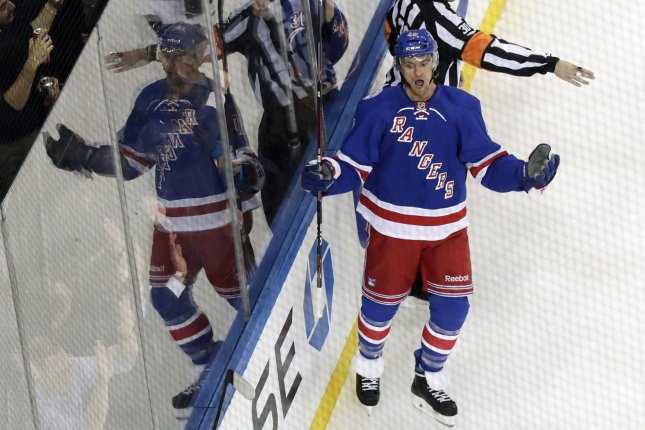 New York Rangers' Michael Grabner reacts after scoring a goal in the first period against the New York Islanders in their opening game of the NHL season at Madison Square Garden in New York City on October 13, 2016. Photo by John Angelillo/UPI