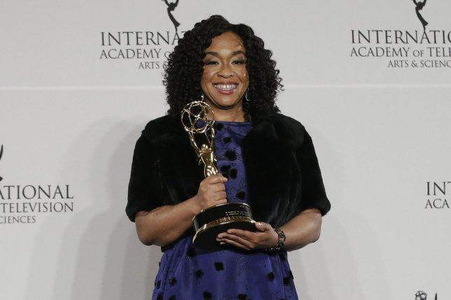 Shonda Rhimes arrives in the press room with her award at the 44th International Emmy Awards on November 21. Rhimes is developing a new Grey's Anatomy spinoff series. File Photo by John Angelillo/UPI