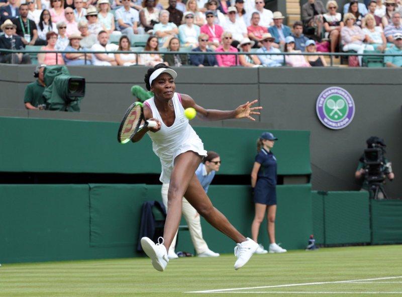Venus Williams returns a shot at Wimbledon. Williams advanced with a win over Naomi Osaka. Photo by Hugo Philpott/UPI