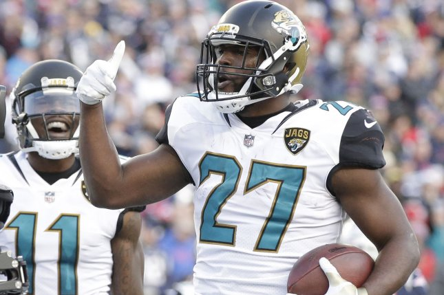 Jacksonville Jaguars running back Leonard Fournettte (27) celebrates 4-yard  touchdown run against the New England Patriots in the second quarter of the  AFC ... 1f5643357