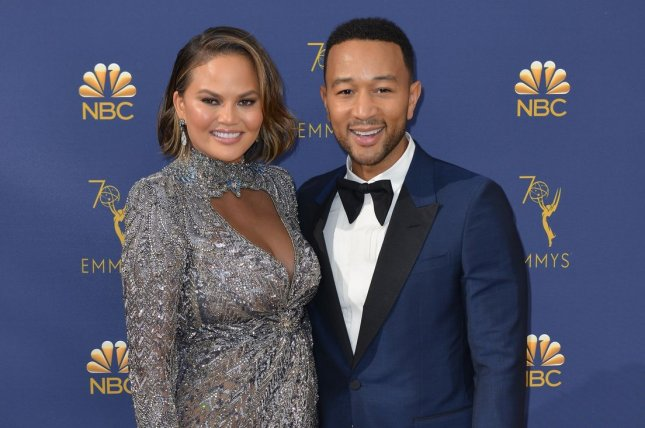 Chrissy Teigen (L), pictured with John Legend, discussed the singer's civil discourse with Kanye West about President Donald Trump. File Photo by Christine Chew/UPI