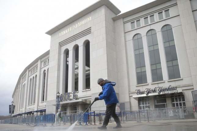 Workers prepare Yankee Stadium to host the first game of the 2021 MLB season Thursday in New York City. Photo by John Angelillo/UPI