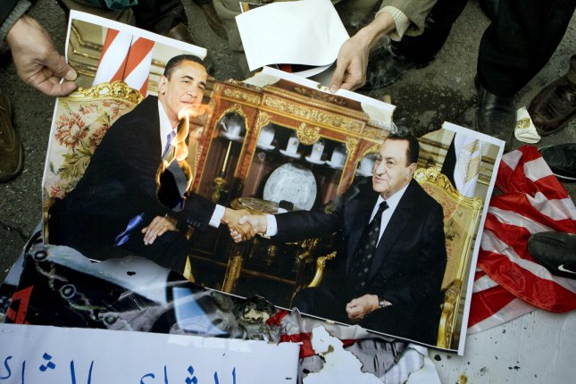 Iranian demonstrators burn a picture of American president Barack Obama during an Anti-Mubarak demonstration, in Tehran, Iran, February 4, 2011. Hundreds of Iranians attended an Anti-Mubarak demonstration to show their solidarity with Egyptian the people. UPI/Maryam Rahmanian