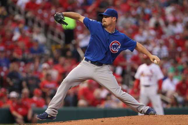 Chicago Cubs starting pitcher Travis Wood delivers a pitch to the St. Louis Cardinals in the first inning at Busch Stadium in St. Louis on May 12, 2014. UPI/Bill Greenblatt