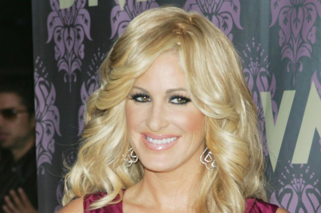Kim Zolciak arrives for the VH1 Divas at the Brooklyn Academy of Music in New York on Sept. 17, 2009. Photo by Laura Cavanaugh/UPI Zolciak was forced to withdraw from Dancing with the Stars, following her recent mini-stroke.