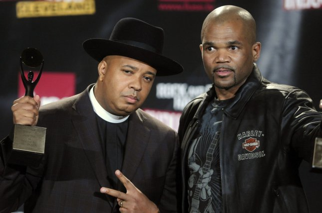 Inductees Joseph Rev Run Simmons (L) and Darryl D.M.C. McDaniels, 2 of the 3 original members of Run-DMC, speak to the press during the Rock and Roll Hall of Fame Induction Ceremony on April 4, 2009. Jason Jam-Master Jay Mizell, the third member of Run-DMC, was inducted posthumously. File Photo by Alexis C. Glenn/UPI