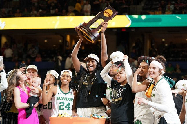 Teams in the men's and women's NCAA basketball tournaments, like the victorious Baylor women's squad last year, won't have fans cheering them on this year. File Photo by Kevin Dietsch/UPI