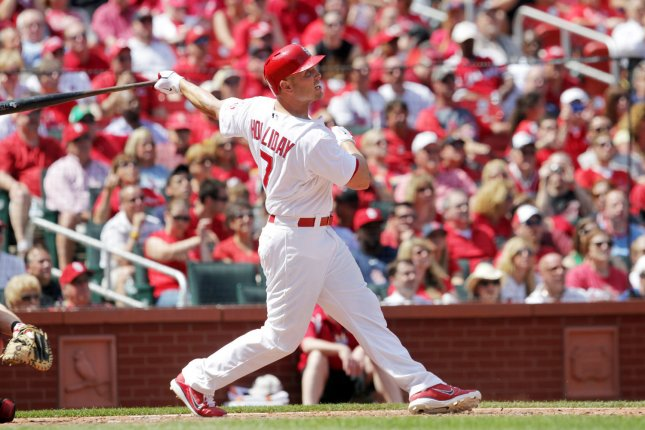 St. Louis Cardinals Matt Holliday watches his three run home run leave the park in the sixth inning against the Cincinnati Reds at Busch Stadium in St. Louis on April 19, 2012. UPI/Bill Greenblatt