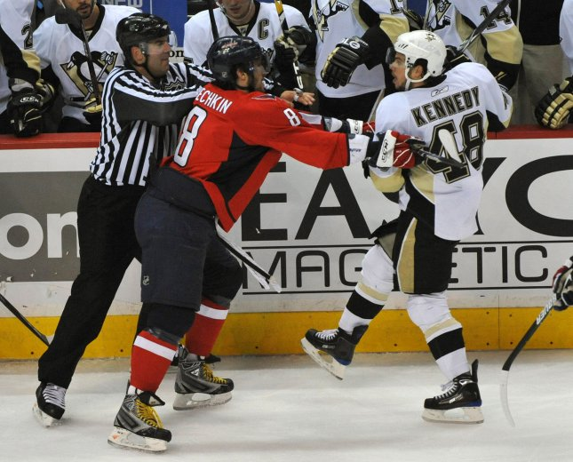 Alexander Ovechkin (8) checks Pittsburgh's Tyler Kennedy (48) on May 4, 2009.. (UPI Photo/Kevin Dietsch)