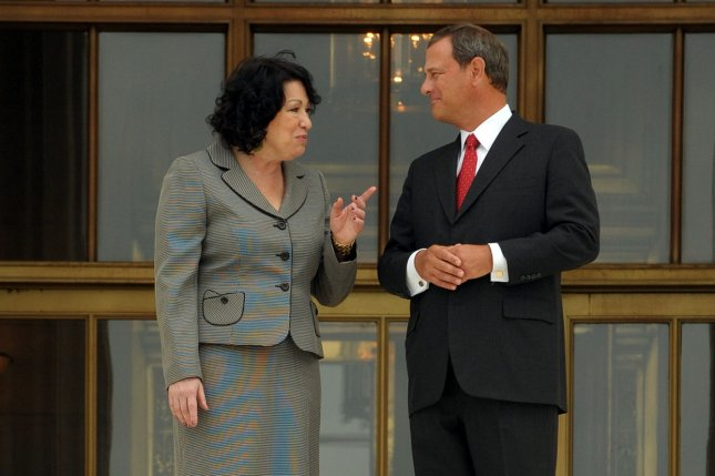 U.S. Supreme Court Justice Sonia Sotomayor and Chief Justice John Roberts chat on the steps of the Supreme Court. UPI/Roger L. Wollenberg