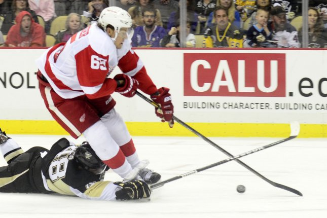 Pittsburgh Penguins center Dominik Uher (48) receives a tripping penalty as Detroit Red Wings defenseman Danny DeKeyser (65) falls to the ice. UPI/Archie Carpenter