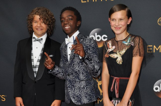 (L-R) Actors Gaten Matarazzo, Caleb McLaughlin and Millie Bobby Brown arrive for the 68th annual Primetime Emmy Awards at Microsoft Theater in Los Angeles on September 18, 2016. File Photo by Christine Chew/UPI