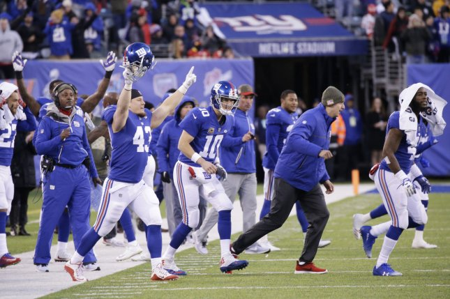 New York Giants Eli Manning and the rest of the bench run to the field after Aldrich Rosas kicks the game winning field goal from 23 yards in overtime against the Kansas City Chiefs in week 11 of the NFL at MetLife Stadium in East Rutherford, New Jersey on November 19, 2017. The Giants defeated the Chiefs 12-9 in overtime. Photo by John Angelillo/UPI
