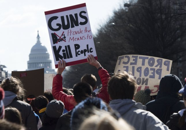 The Illinois state senate approved three bills placing new restriction on the purchase and ownership of firearms and accessories such as bump stocks Wednesday as National School Walkout demonstrations, like the one pictured here, took place. Photo by Kevin Dietsch/UPI