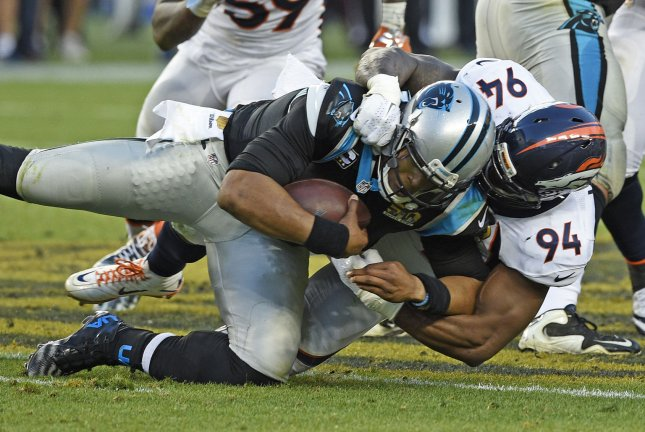 Former Denver Broncos linebacker DeMarcus Ware (94) takes down Carolina Panthers quarterback Cam Newton in the second quarter of Super Bowl 50 on February 7, 2016 at Levi's Stadium in Santa Clara, California. File photo by Brian Kersey/UPI