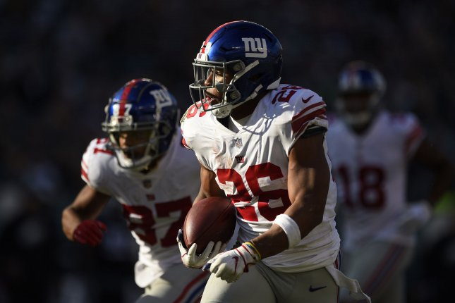New York Giants running back Saquon Barkley runs the ball for a touchdown during the first half of an NFL football game against the Philadelphia Eagles on November 25 at Lincoln Financial Field in Philadelphia. Photo by Derik Hamilton/UPI