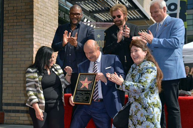(L-R) Hollywood Chamber of Commerce President/CEO Rana Ghadban, Tyler Perry, Dr. Phil McGraw, Ronnie Dunn and Donelle Dadigan attend the star unveiling ceremony honoring McGraw on Friday. Photo by Chris Chew/UPI