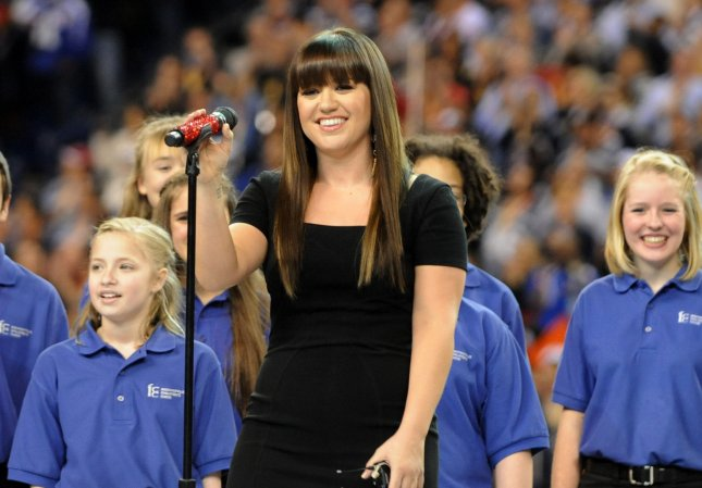 Singer Kelly Clarkson performs the U.S. National Anthem prior to the start of Super Bowl XLVI between the New York Giants and the New England Patriots at Lucas Oil Stadium for NFL in Indianapolis, Indiana on February 5, 2012. UPI/Pat Benic
