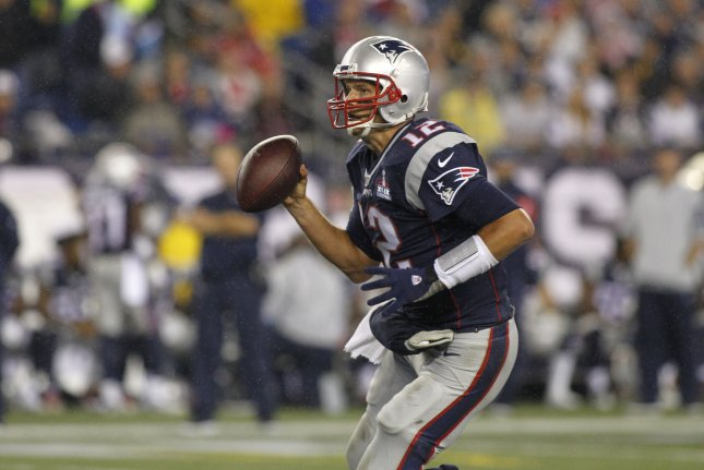 New England Patriots quarterback Tom Brady (12) scrambles on a play in the  second quarter against the Pittsburgh Steelers at Gillette Stadium in  Foxborough 20fac8ebb