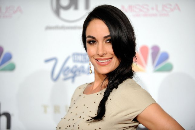 Brie Bella arrives at the 2013 Miss USA competition on June 16, 2013. Following her match at WrestlMania, Bella has confrimed her retirement from in-ring action. File Photo by David Becker/UPI